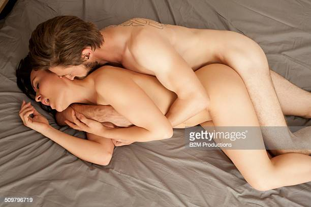 Nude couple sex posture on bed